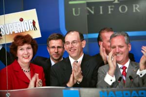 Robin Hensley with company executives at the NASDAQ closing bell ceremony for Superior Uniform Group where she serves as board member and Audit Committee Chair.